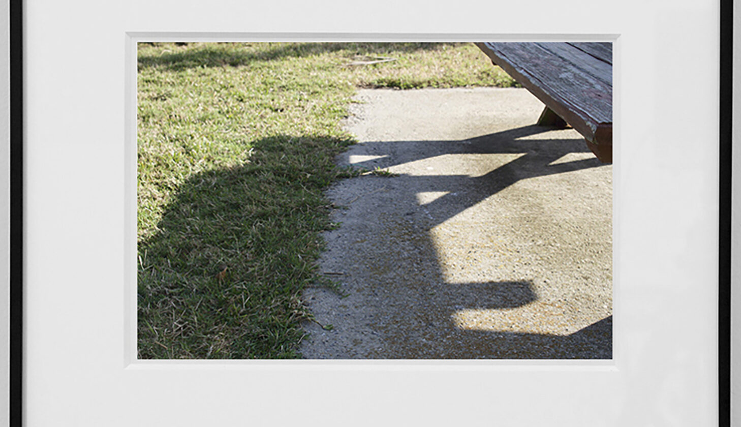 Park McArthur photograph depicting shadows of picnic table, from McArthur Park Overlook series