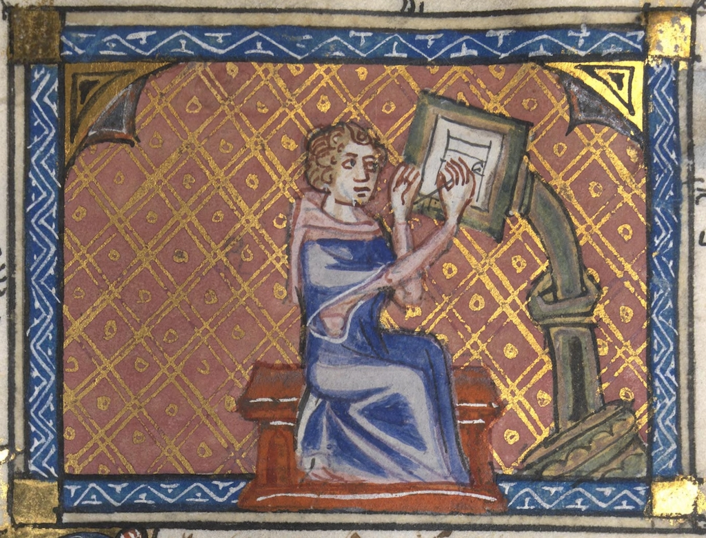 Medieval monk working on a manuscript